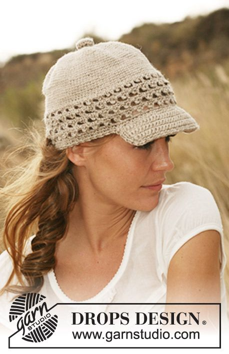 6372b9f88cd Crochet DROPS cap with brim and lace pattern border in