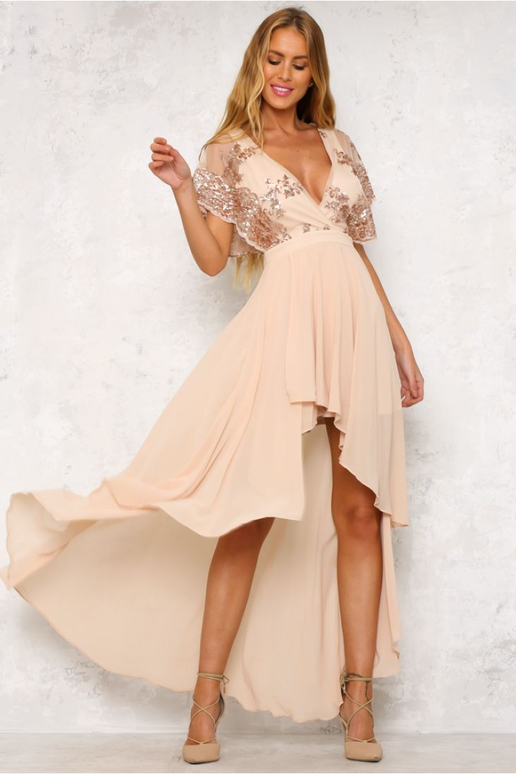 The gorgeous close to the edge maxi dress features beautiful sequin