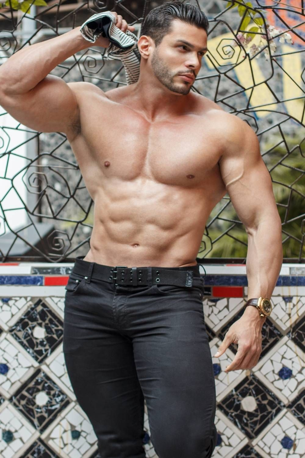 Handsome young man isolated. Shirtless muscular man in