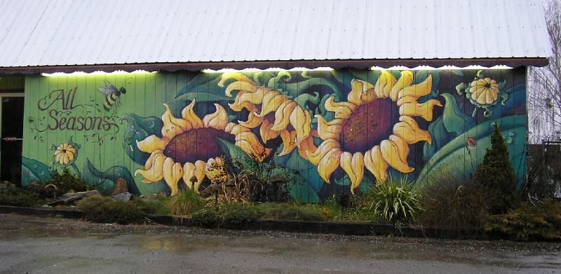 gorgeous sunflower mural on the exterior of a plant-related business (nursery? greengrocer?)