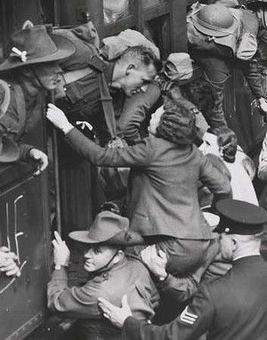 ON A crowded railway platform, two soldiers hoist a woman on their shoulders so she can kiss her sweetheart goodbye. Or perhaps she was the man's sister, saying a last goodbye as he was shipped off to the Second World War.  August 14, 1940.