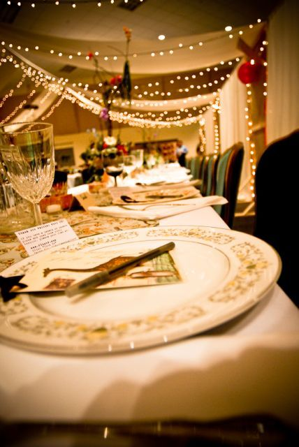 """Each plate had a postcard and pen.  This served as the guest book - postcards had ribbon to tie them to each tables """"tree"""" centerpiece."""