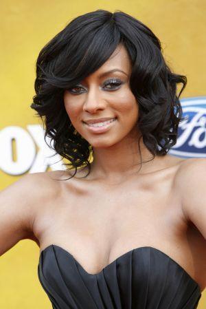 Voluminous medium length style for African American women  hair