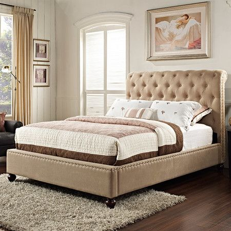 Showcasing nailhead-trim and a scrolled button-tufted headboard, this sophisticated bed brims with refined appeal.  Product: Bed...