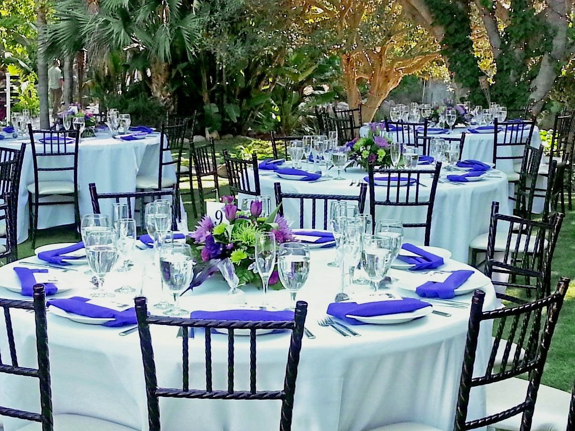Purple napkins white tablecloths chiavari chairs by Anything But
