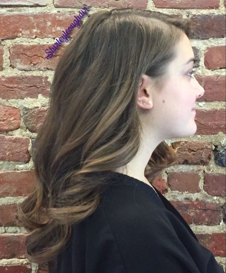 Strong parting with curls, one side tucked behind the ear ...
