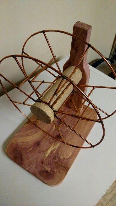Rotating wine rack cedar oak and welding wire spool for Small wire spool ideas