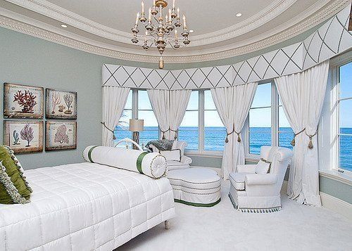 White, big bedroom on ocean