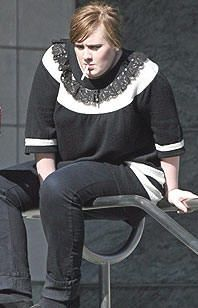 Adele smoking a cigarette (or weed)