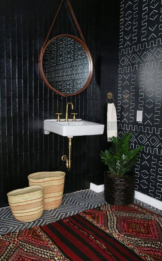 This black bathroom is accented with an even bolder black patterned wall. The combination of patterns plays well off of each other.