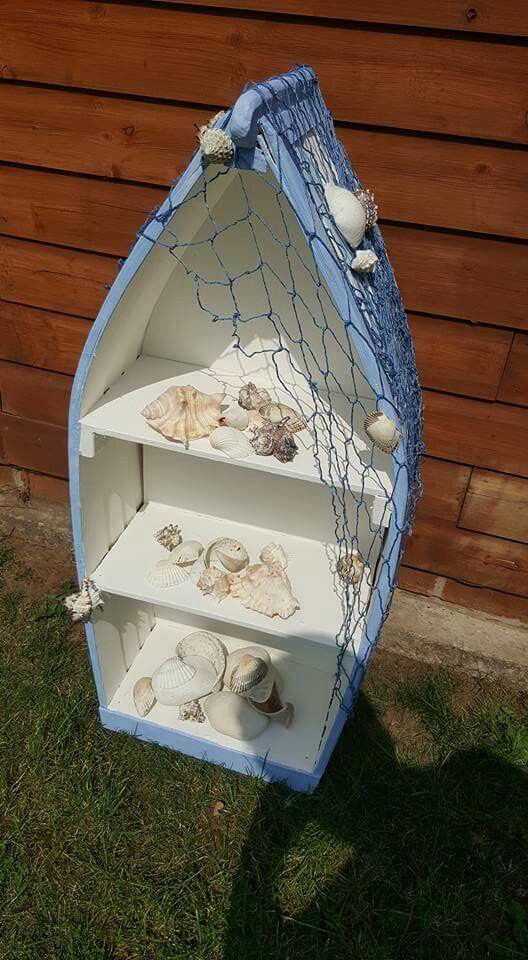 I wanted a boat shaped shelf unit for my seaside themed bathroom but they were all a bit pricey - so my hubby said he'd  make me one  I painted it with white emulsion and a couple of blue tester pots and decorated it with a blue net from eBay and some shells I already had.  I love it