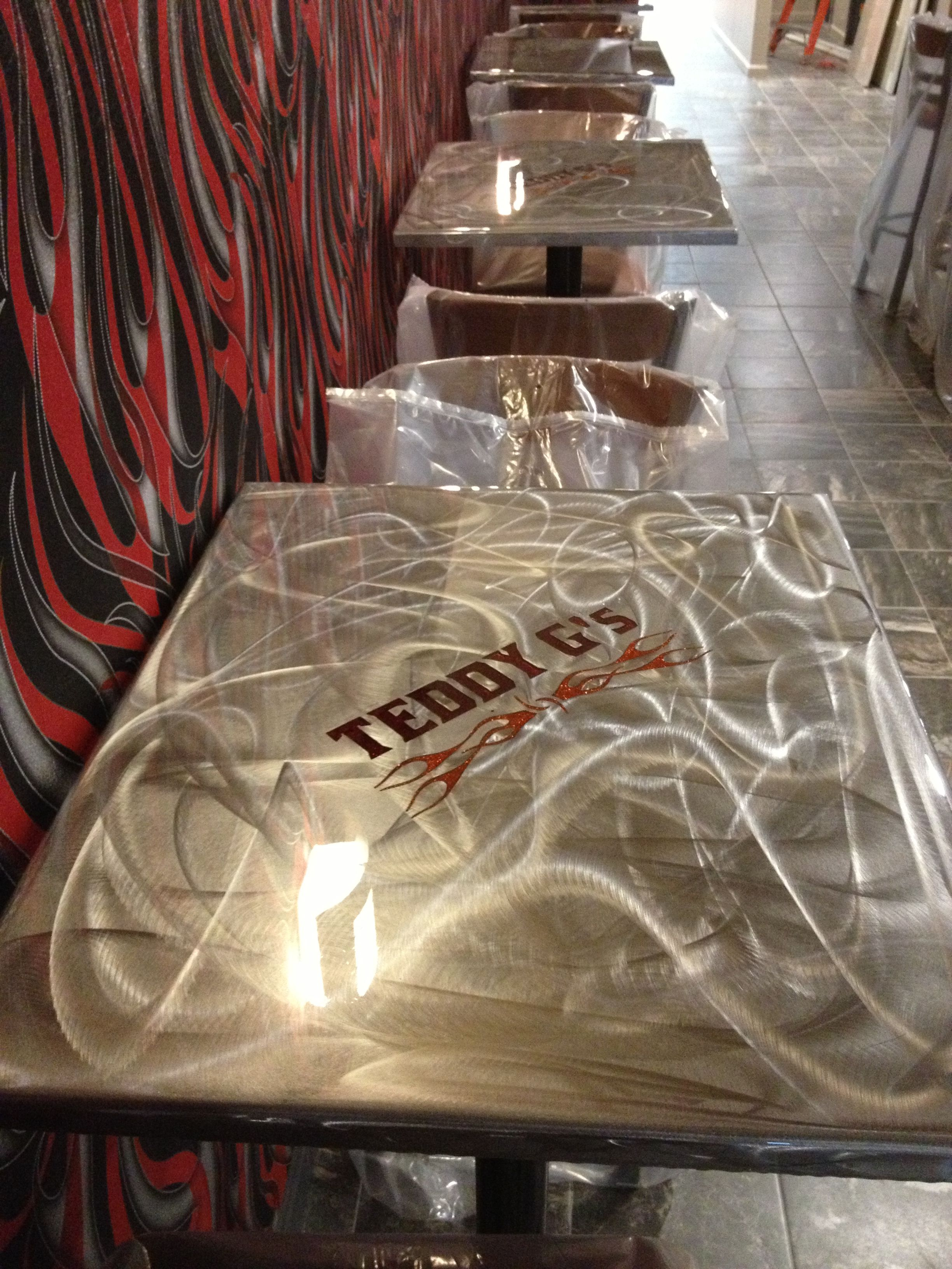 Steel Table Top With Plasma Cut Logo. Metallic Epoxy Inlay And Top Coated  With Clear