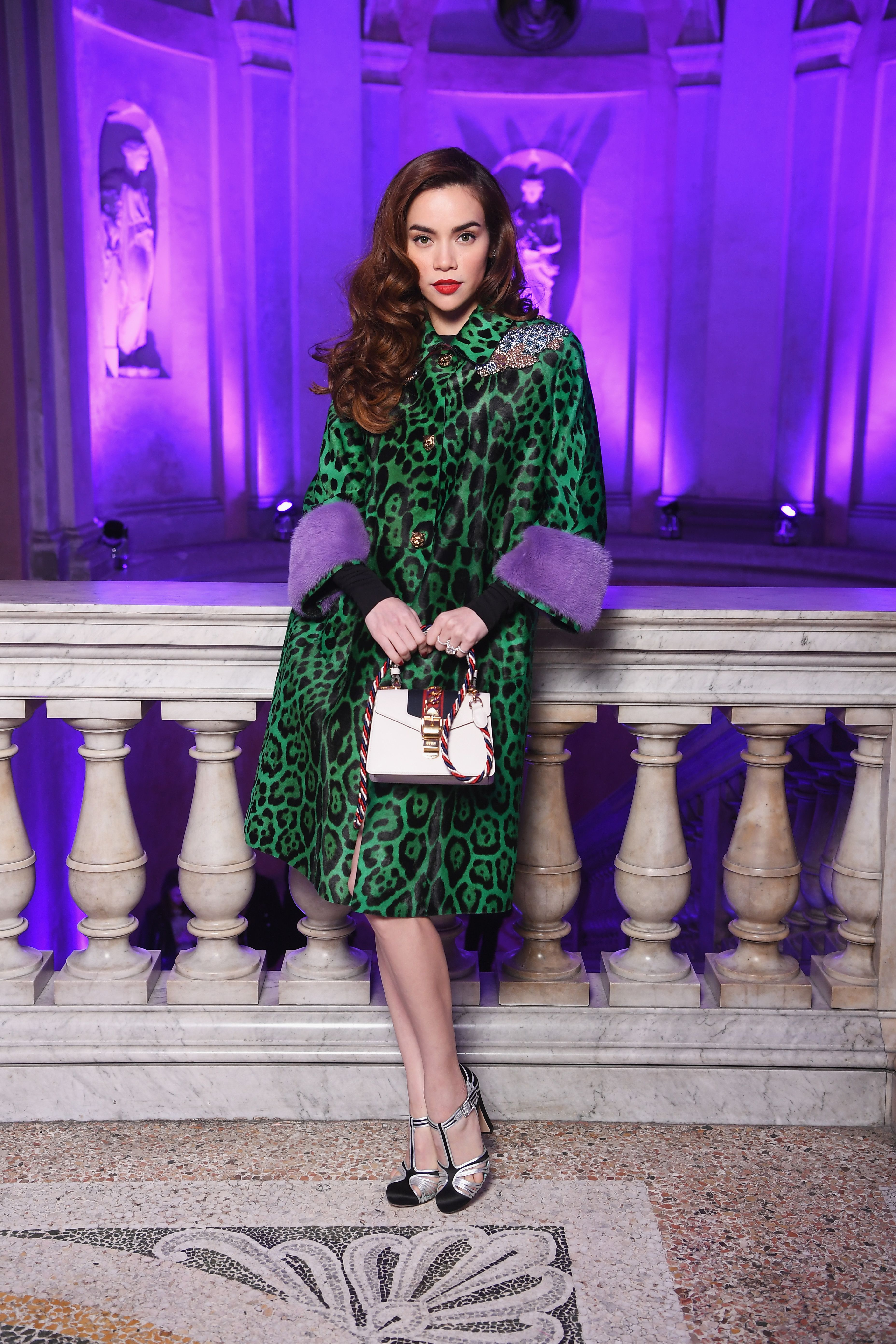 feabf221 Ho Ngoc Ha in a printed coat with tiger head metal buttons and jewelled  patch details, metallic leather pumps and Sylvie mini bag.