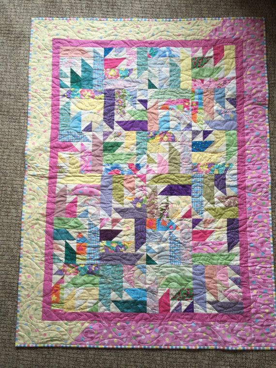 This quilt was made using all high quality scraps! There are 344 pieces in the center blocks alone! I added a two color border for extra