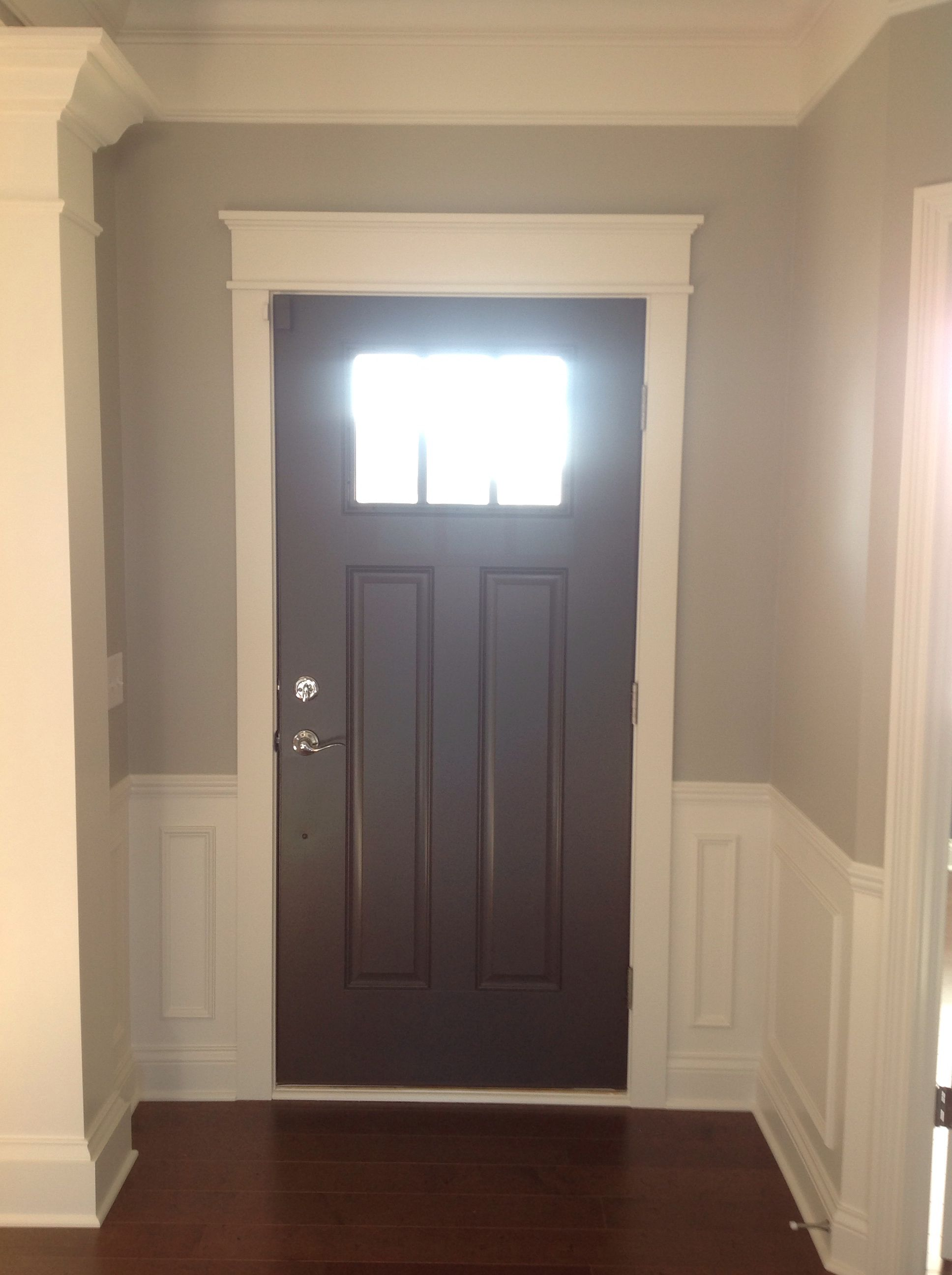 Changed Out The Door Trim And Added Some Character By Painting It Sw Black Fox Love How Much It Stands House Color Schemes Cedar Homes Painted Interior Doors