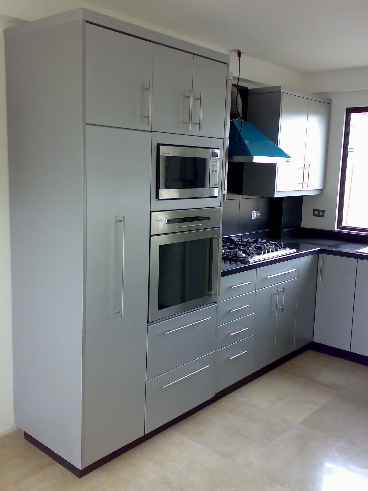 Kitchen With Pantry Built In Oven Microwave And Cooktop Kitchen