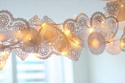 A pretty lit garland de from heart doilies and flower bouquet