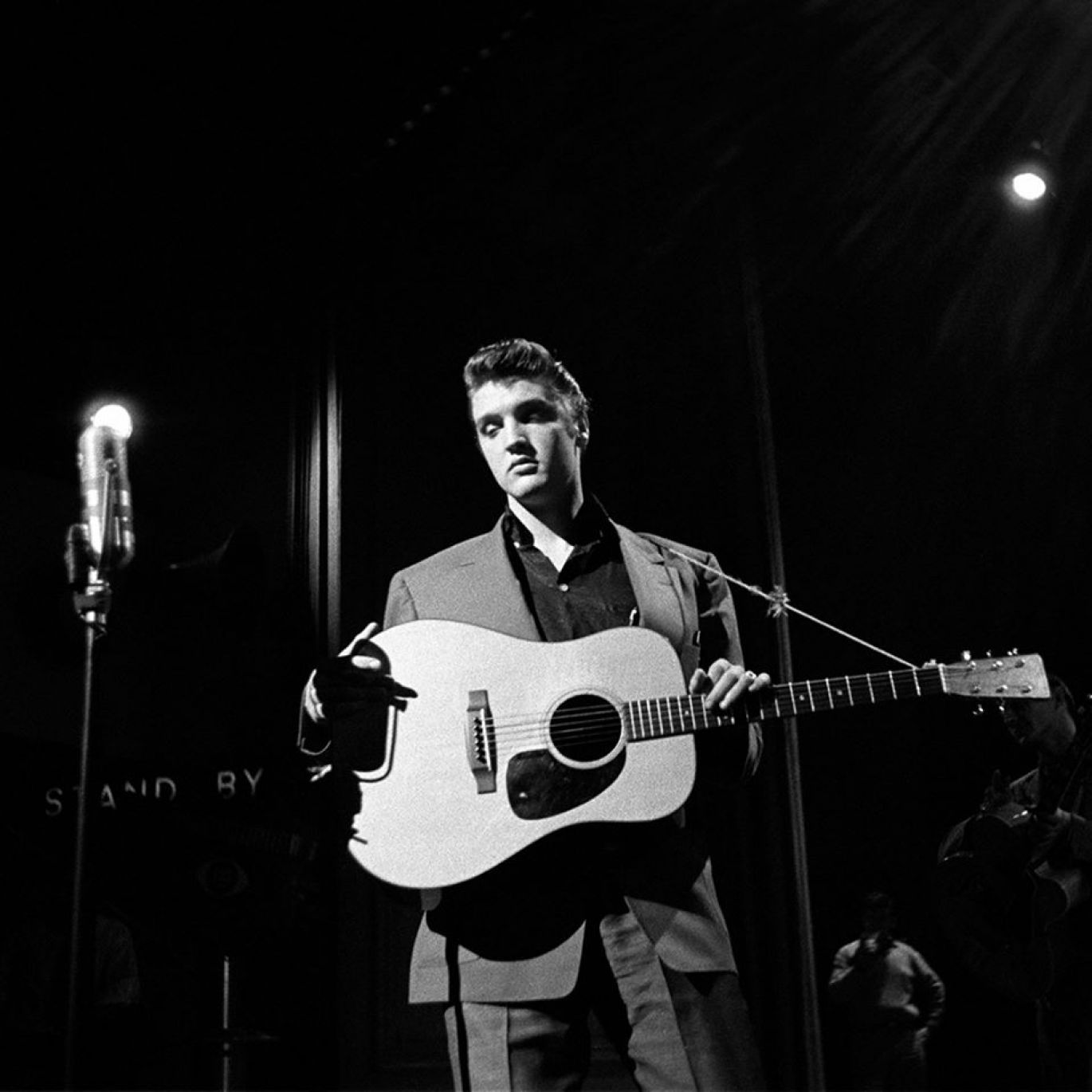 """Elvis Presley photographed by freelance photographer Alfred Wertheimer rehearsing at CBS-TV studio 50 in New York City on Saturday, March 17, 1956. He was going to perform for the fifth time on the Dorsey Brothers """"Stage Show"""", singing """"Heartbreak Hotel"""" and """"Blue Suede Shoes""""."""
