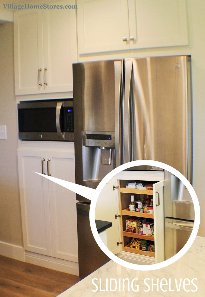 A built-in microwave is located in the center of a tall ...