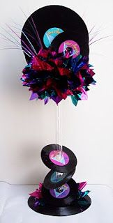 The base of the centerpiece was a 33 record with mylar tissue in the hot pink, purple and teal colors as accents as well as at the top of th...