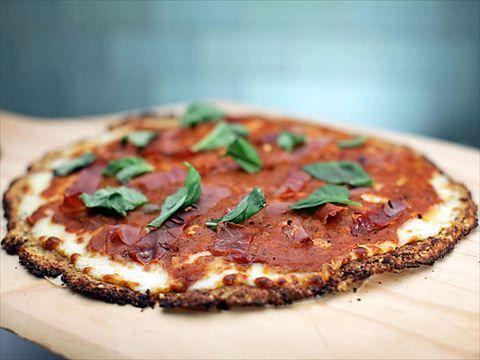 Cauliflower pizza crust video food network cauliflower pizza our food network kitchens recipe for gluten free cauliflower pizza crust video forumfinder Images