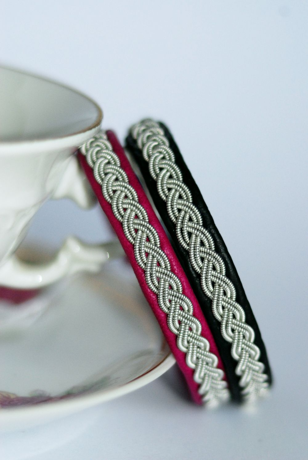 Handmade bracelets by Gjersvold Design. Made with leather from reindeer and pewter/silver thread.