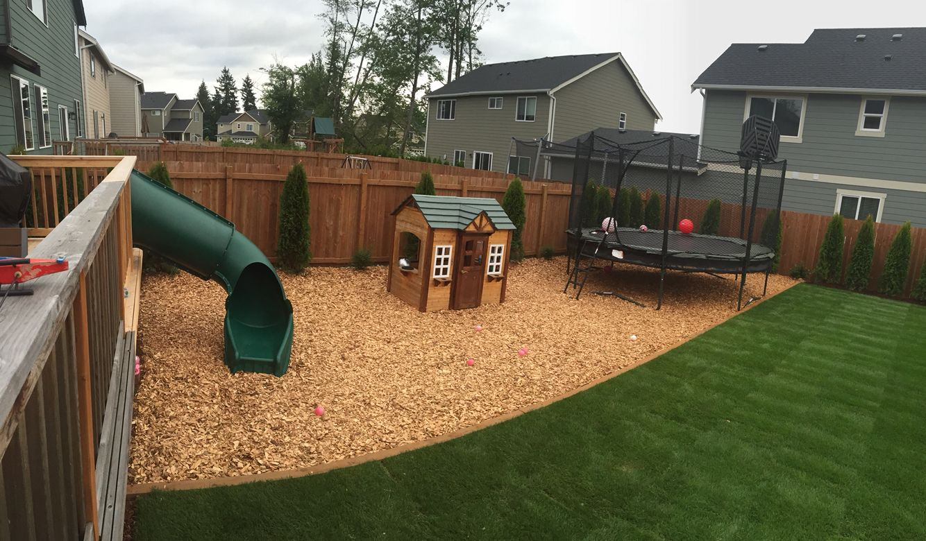 Backyard update! Play area with slide off the deck ...
