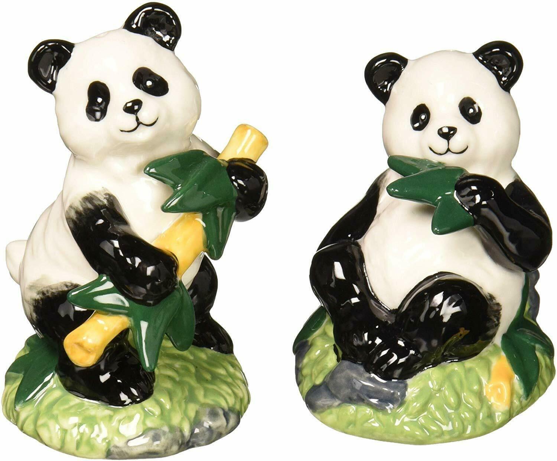 Black and white panda eating bamboo salt and pepper