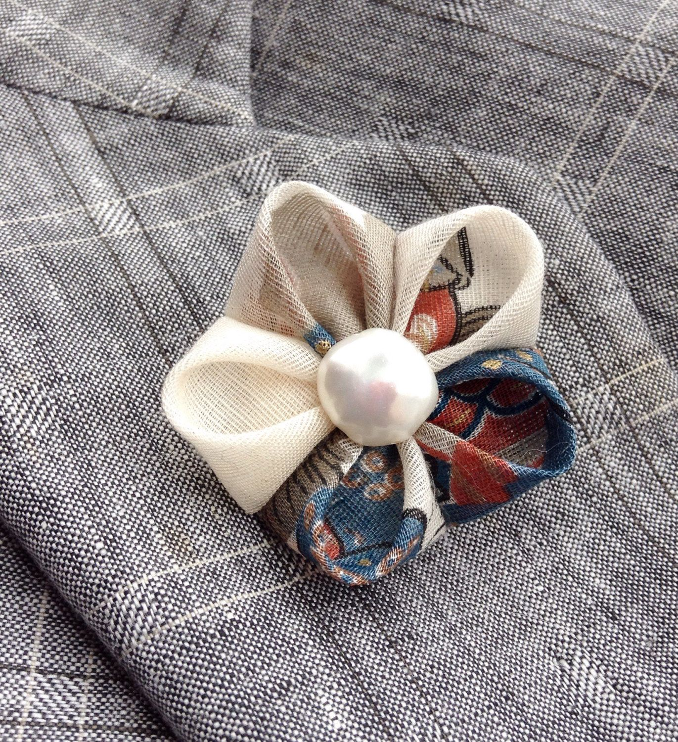 A fall colors lapel flower boutonniere pin for modern guys, made in the Japanese tsumami kanzashi style! These attention-grabbing pins are all slightly different, and are the day to night mens fashion accessory no one else can own. I used a vintage Japanese linen to make this whimsical lapel pin. I attached a coin pearl to the center, and mounted everything on a tie tack with a butterfly clutch back. The modeled photo is an earlier version. Complements a suit, blazer, overcoat, hat…