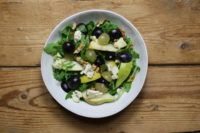 Autumn salad with lettuce, grapes, pears, cheese and nuts