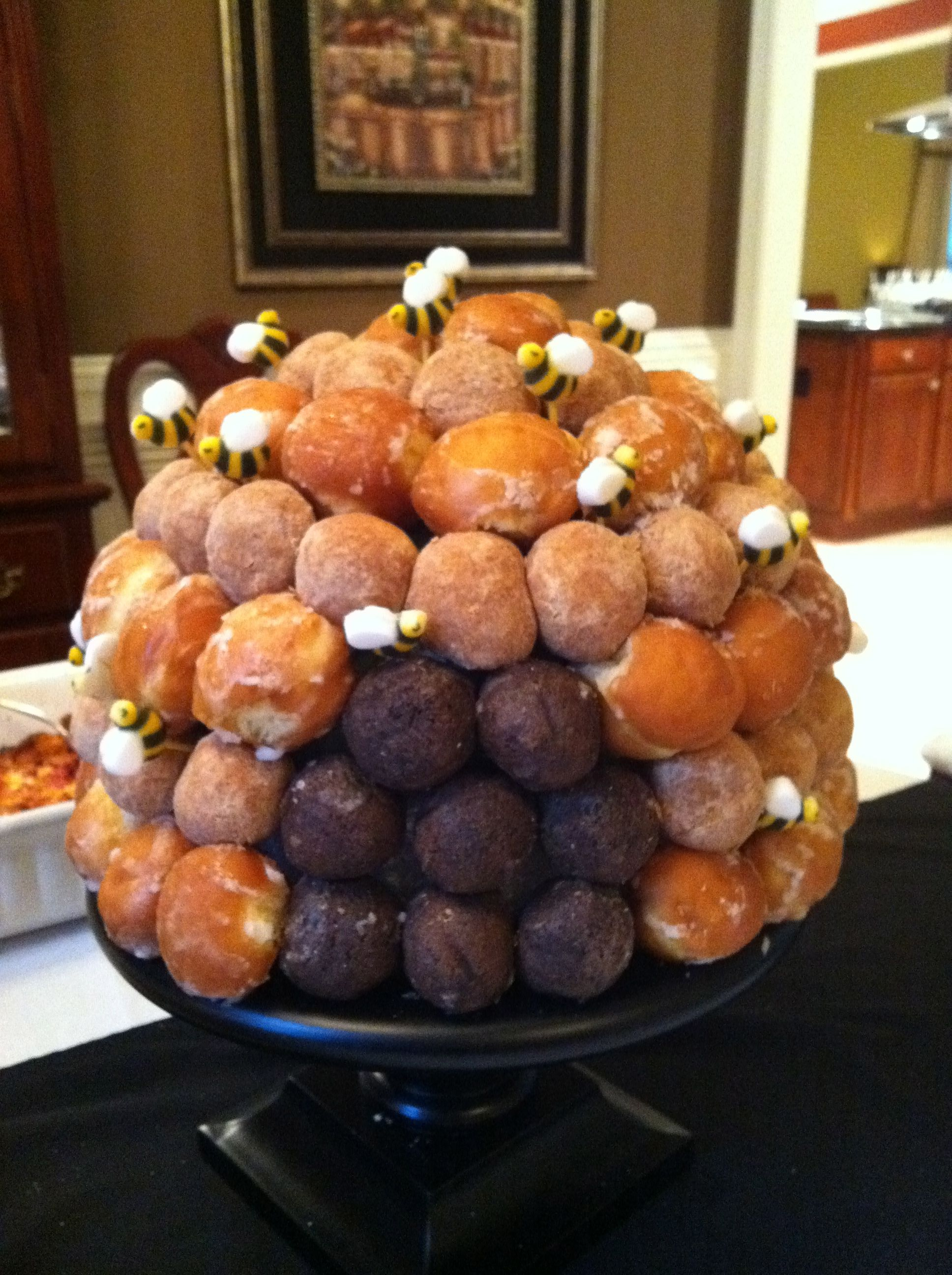 bumble bee hive made from donut holes...simply use a half sphere piece of styrofoam and use toothpicks to stick the donut holes on. Great for a birthday party