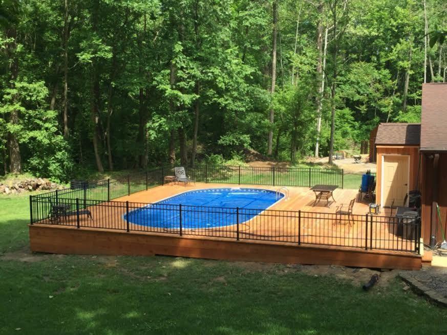 Radiant Semi Inground Oval With Full Deck Backyard Pool