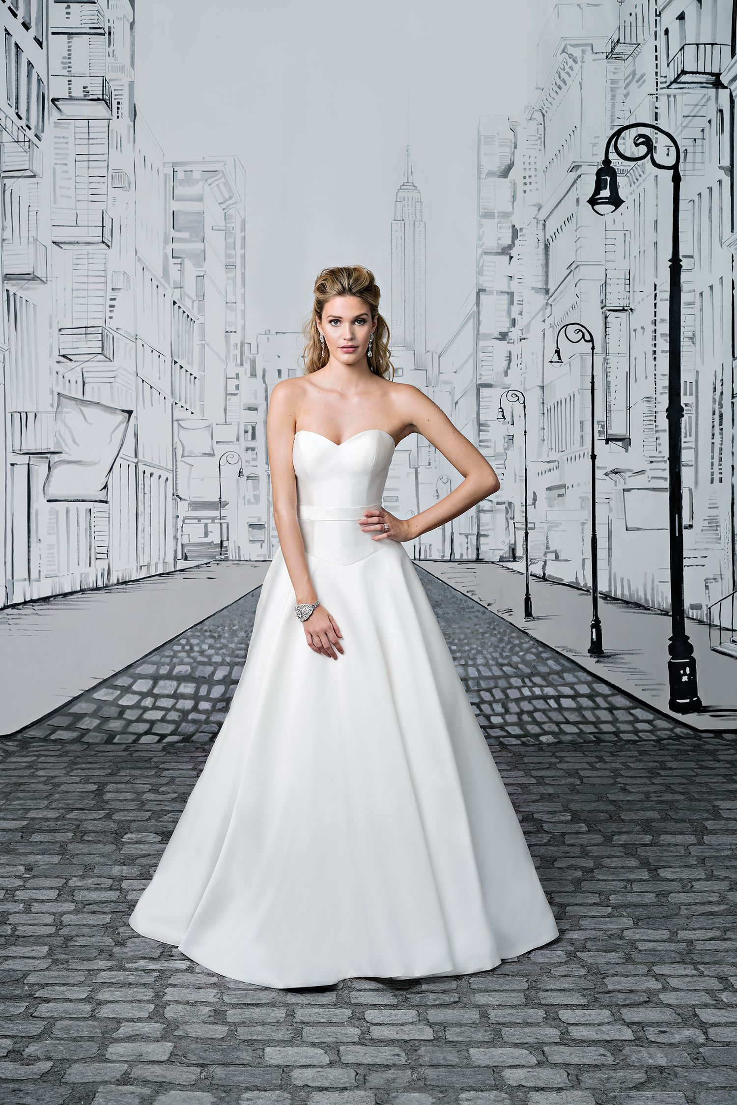 Clean lines create this Mikado ball gown with a sweetheart neckline ...