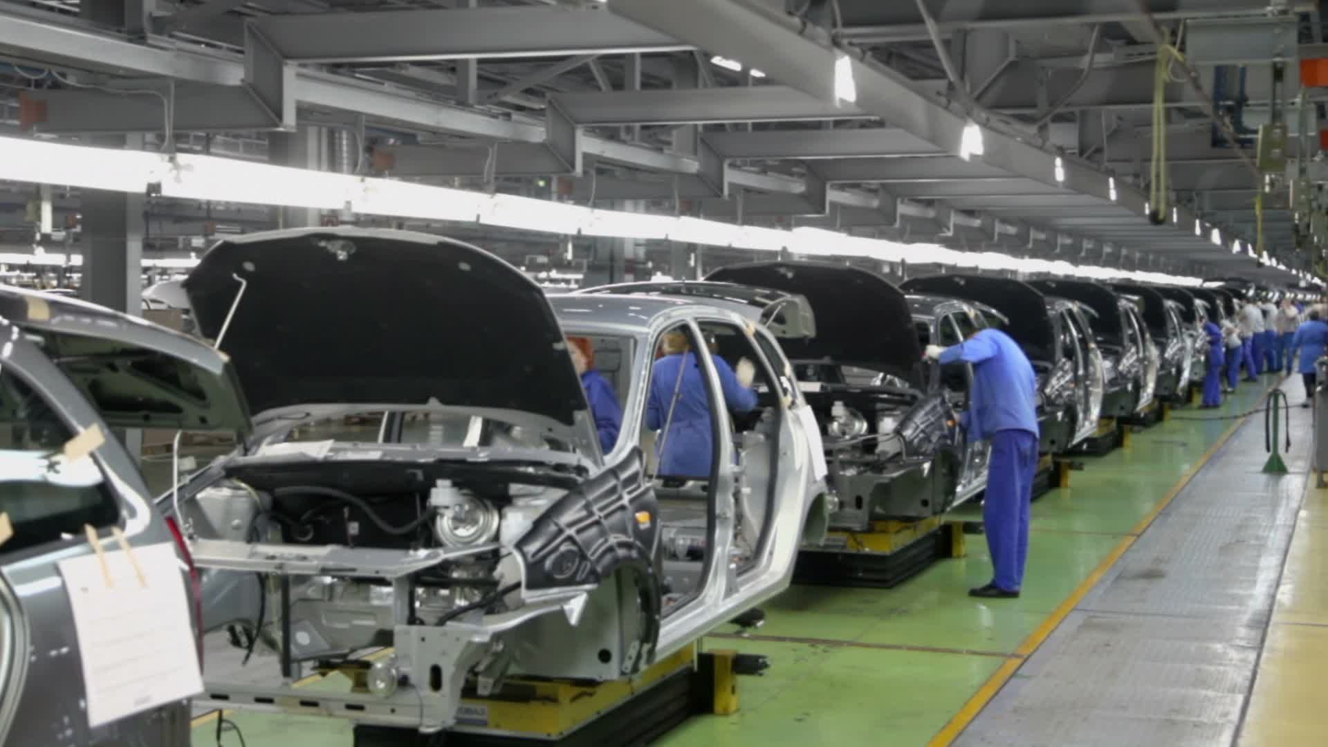 Workers Assemble Cars Lada Kalina On Conveyer Of Factory Vaz Stock