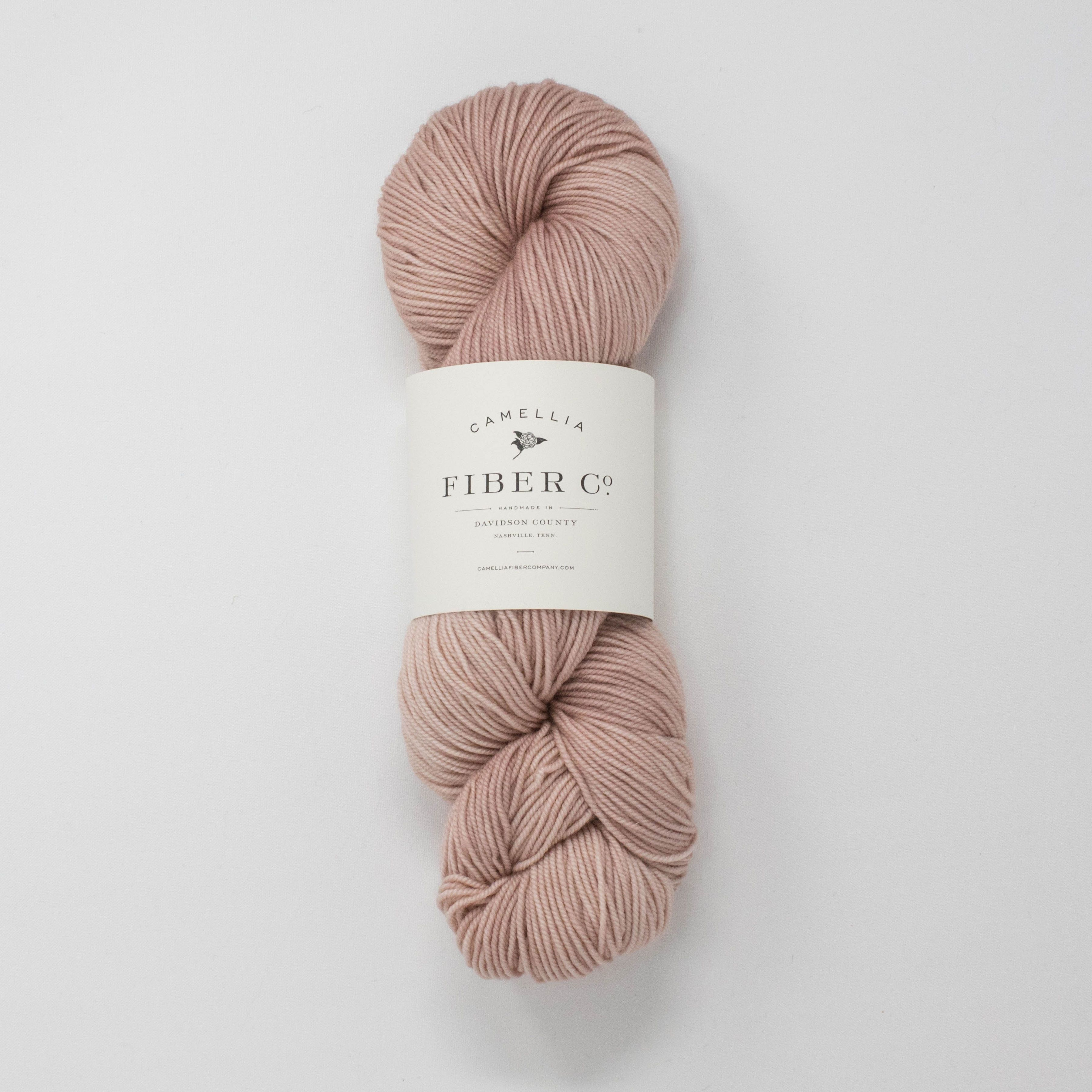100% merino wool in a 3-ply sport weight yarn. This is our go-to yarn for babies and children's items, as it is warm, durable, and next-to-skin soft. It also makes the most wonderful cozy socks! Yards: 325 Weight: 3.5 oz Recommended needle size: US 4-5, 3.5-3.75mm