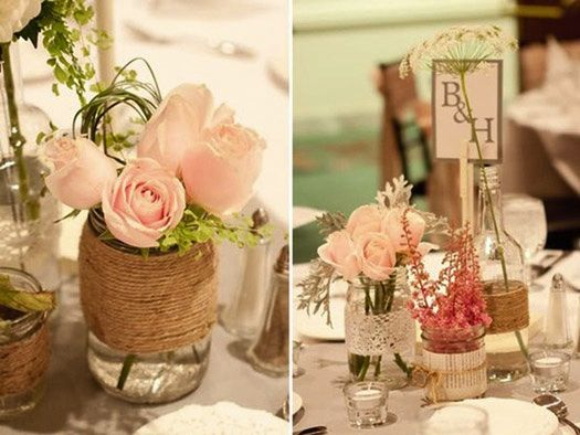 Twine-wrapped vintage jars filled with blush roses