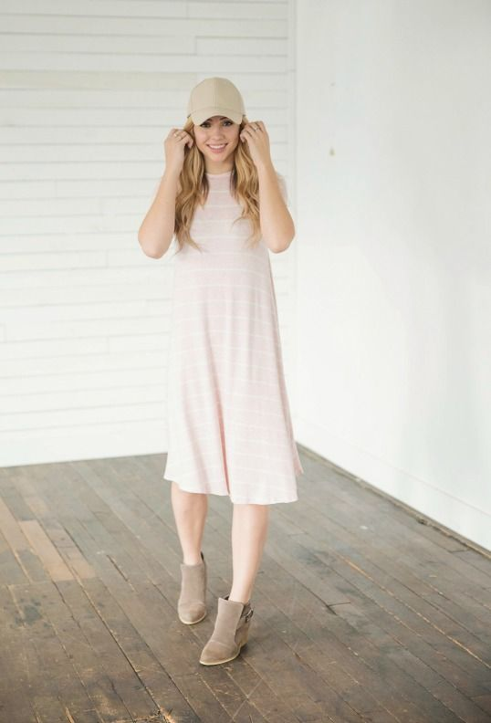 The Art Of Spring Pink Midi Dress less is always more! This dress is very versatile and can be paired with any of your favorite accessories. || Bella Ella Boutique