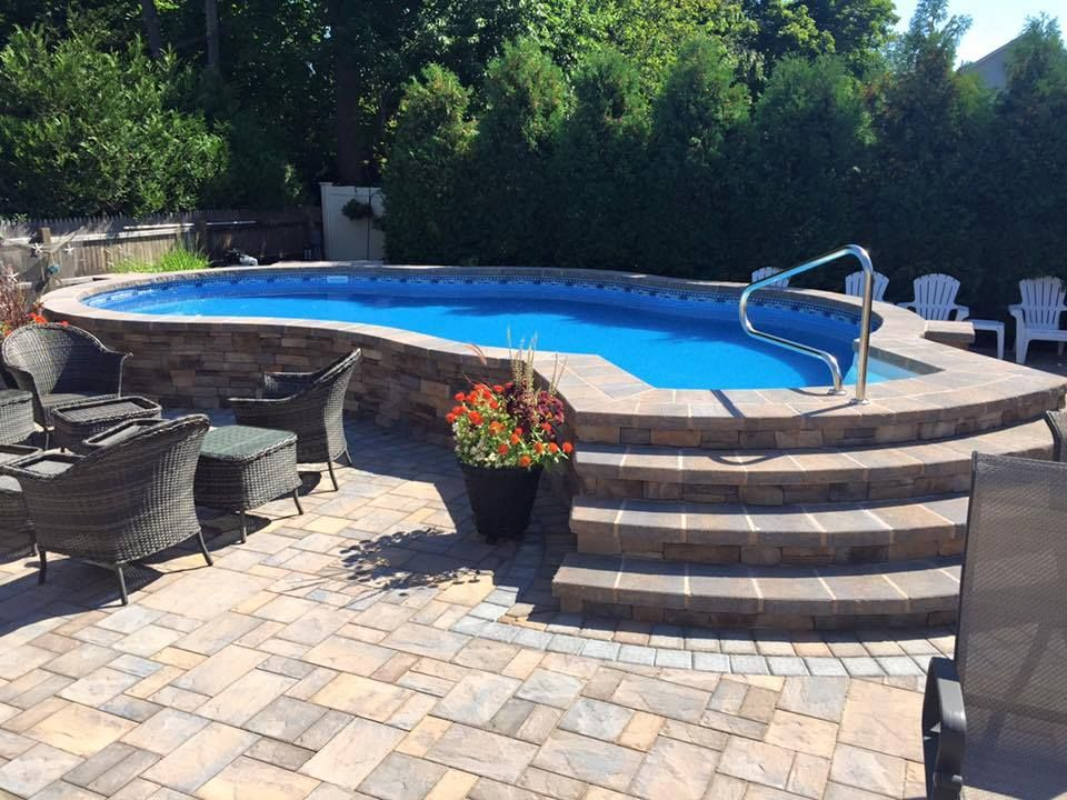 Stone And Seating Area That S How You Do An Above Ground Beautifully Above Ground Pool Landscaping Oval Pool Backyard Pool Landscaping