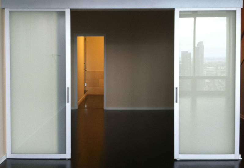 Suspended Glass Doors Slide Smoothly Open And Closed With No Bottom