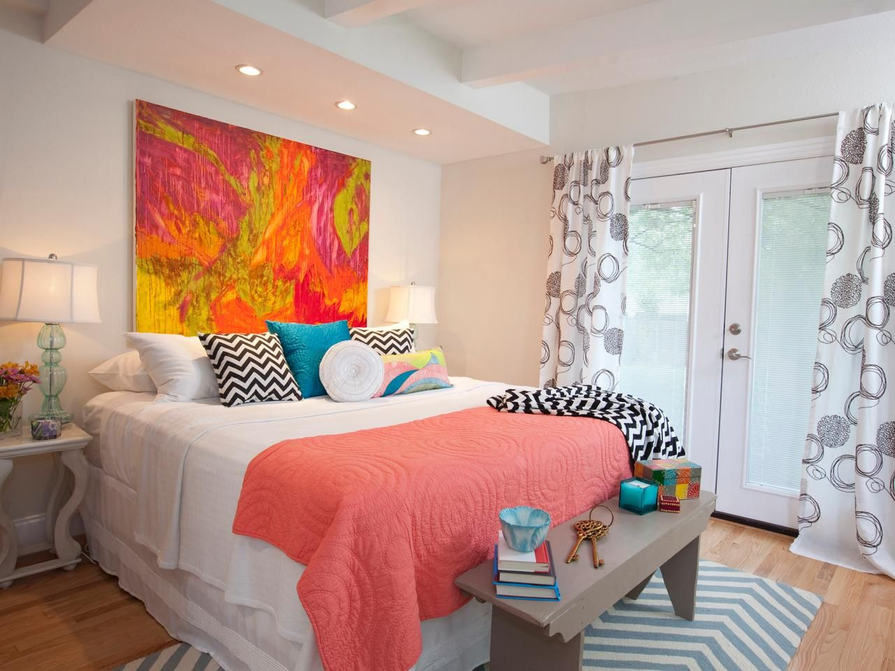 The Bold, Colorful Artwork In This White Master Bedroom Breathes Life Into  The Space.