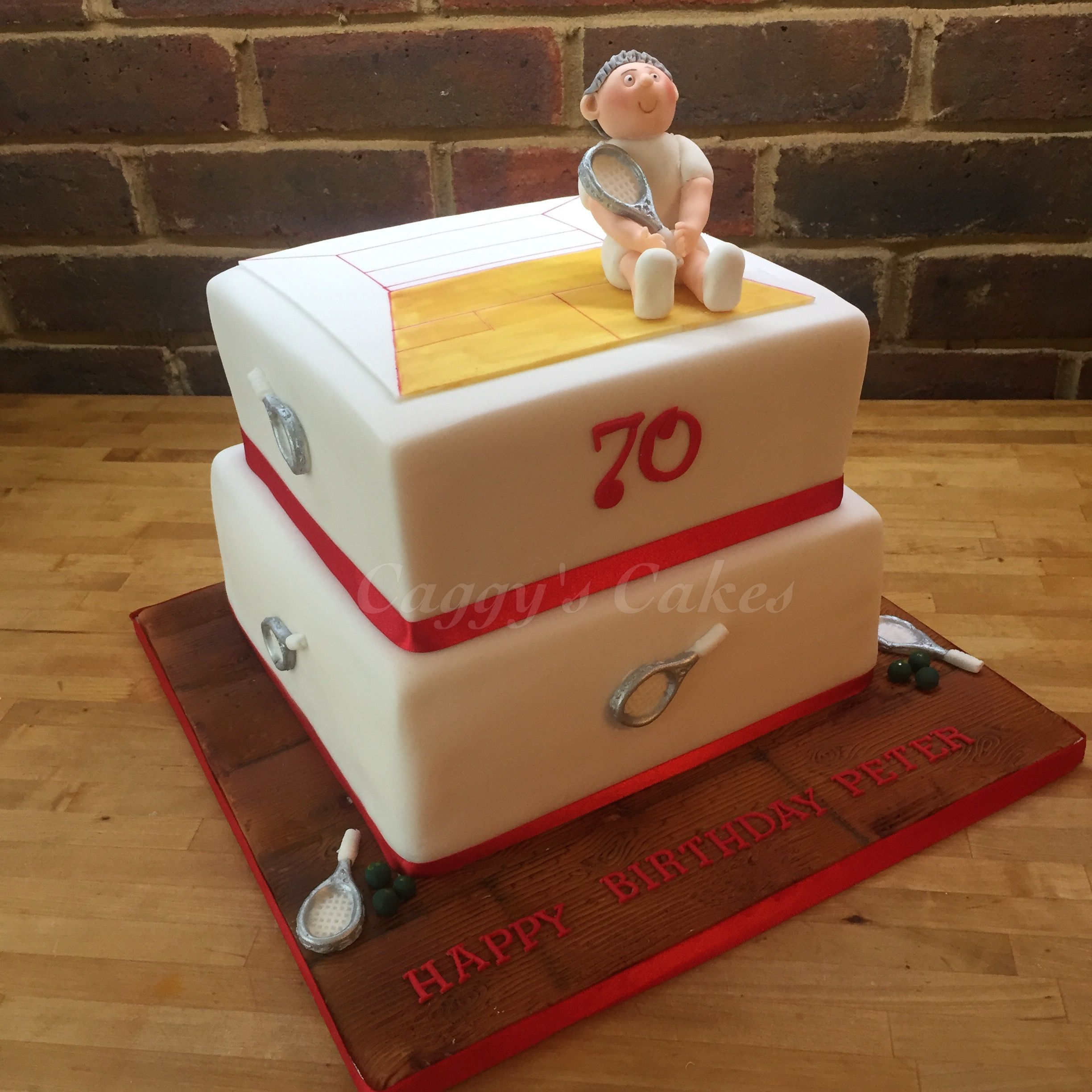 2 tier squash theme cake with squash court in 2D and model of the