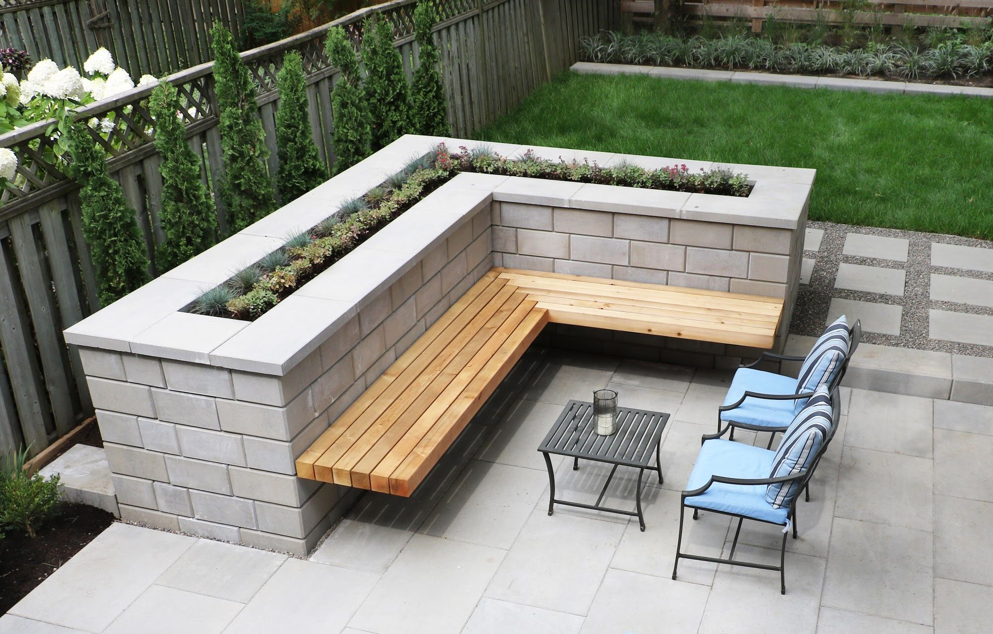 Floating Cedar Bench On Techo Bloc Raffinato Retaining Wall