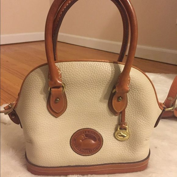 Vintage Dooney & Bourke Norfolk handbag Vintage Dooney & Bourke Norfolk Handbag all weather leather. Very versatile purse. It has a stain on the bottom (hence the lower price). Super cute purse though that goes with a variety of looks. Dooney & Bourke Bags Satchels