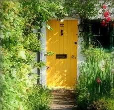 Bright Yellow Door Surrounded By Nature