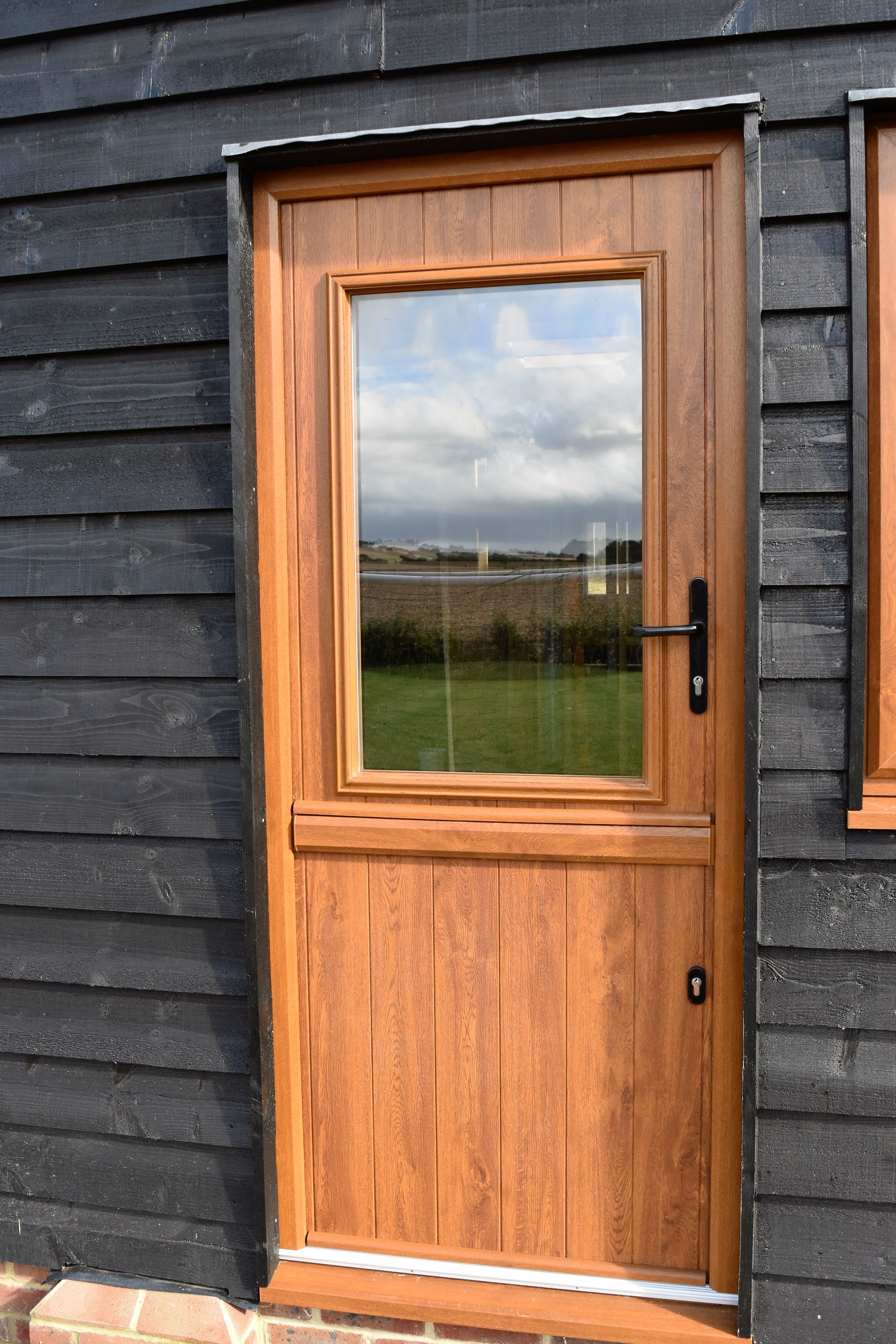 Golden Oak Stable Door Solidor On Country Home With Black