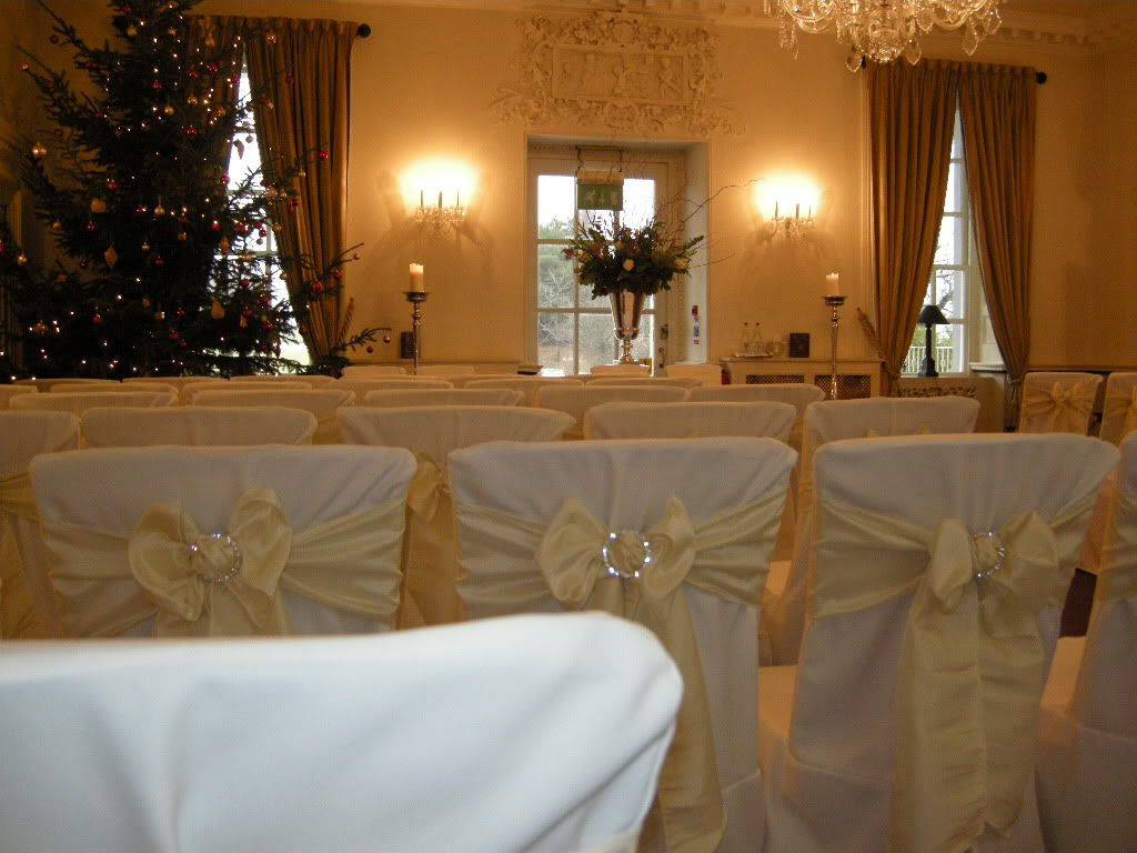 Wedding Chair Cover Hire Brighton Outside Rocking Canada Buxted Park Hotel Sussex Christmas Venue Bespoke Linen Covers And Cream Taffeta Sash Bow Brooch Decoration From Pollen4hire Floral