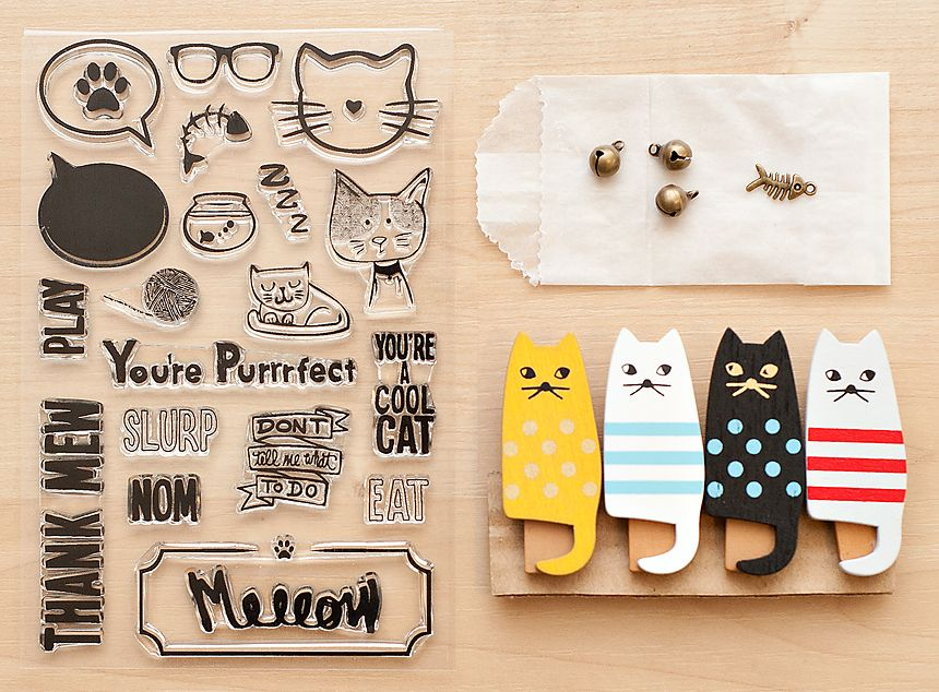 "Cat Lover's Mini Kit from @Studio_Calico - A kit devoted entirely to cats? You've got to be ""kitten"" me! This cat themed mini kit includes a 4x6 stamp set, 4 cat clothespins, 3 bell charms, and a fish bone charm. Perfect for scrapping about my cat Rachel (named after Rachel Green of FRIENDS - another obsession of mine!)"