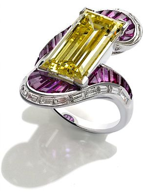 Platinum ring set with a natural fancy yellow diamond, rubies and baguette diamonds, by Fochtmann