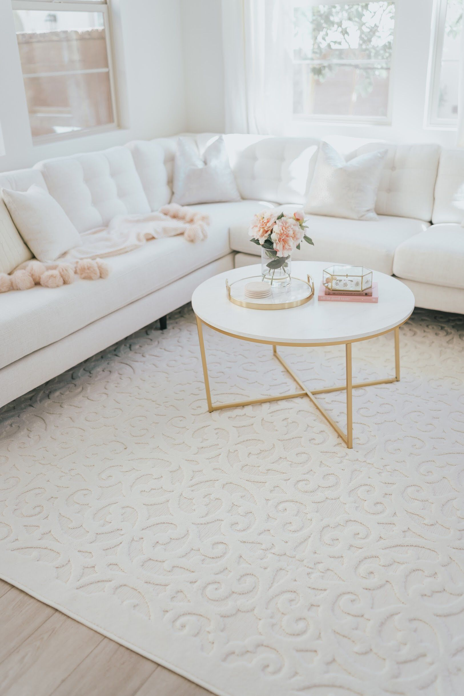 White Living Room With Gold Marble Coffee Table A Touch Of Pink Blog Inexpensive Living Room Living Room Decor Apartment Gold Living Room