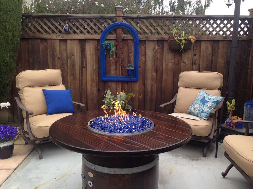 Cobalt Blue Fire Glass In The Wine Barrel Fire Table.